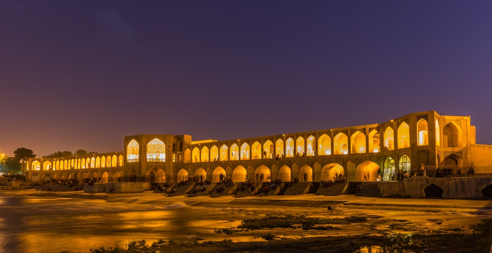 ISFAHAN, IRAN - APRIL 28, 2015: unidentified people resting in the ancient Khaju Bridge, (Pol-e Khaju), in Isfahan, Iran